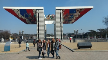 In front of the Olympic Gate